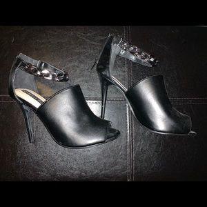 Black open toe heel with metal chain